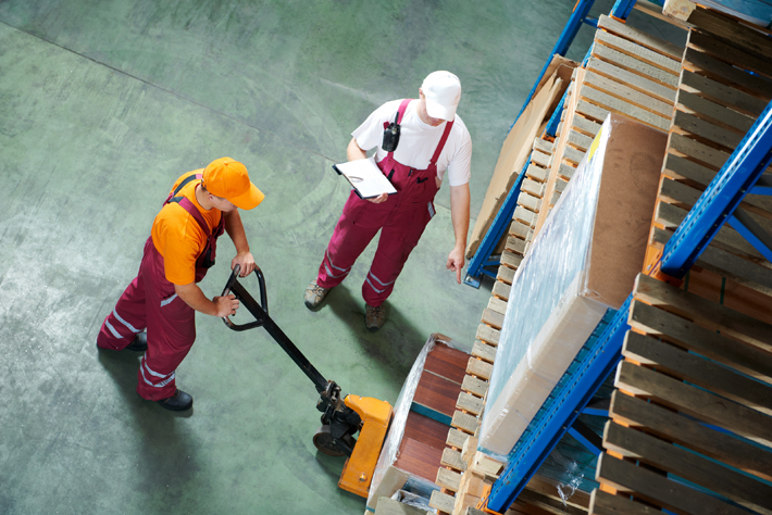 Men working in a warehouse. Link to the Personal protective equipment page.